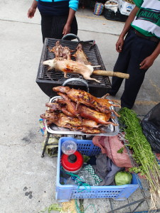 A specialty in Ecuador: grilled guinea pigs (Cuy)